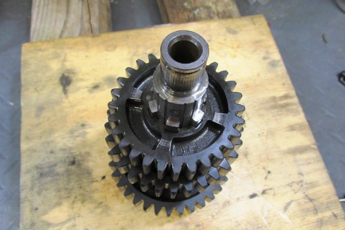 Output Shaft With 3rd Gear Side Facing 5th Gear Has Slots For Dog Teeth To Engage