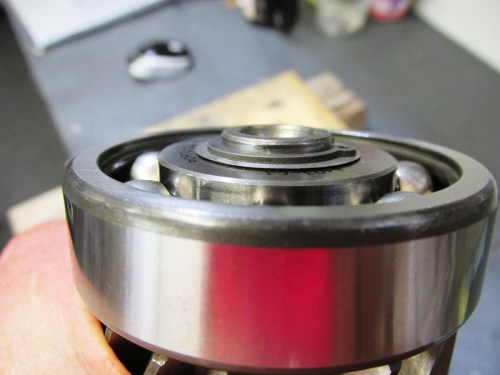 Verify Output Shaft 5th Gear Bearing Lock Ring Is Uniformly In The Groove
