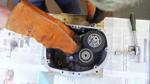 Install Output Shift Forks Into Slots In Gears and Shaft Into Hole In Housing