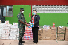 UNICEF's Sylvia Fouet handing over supplies to CDC's Director General, Lt. Col. Kester Craig
