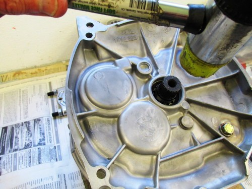 Sharply Rap On Input Shaft With Plastic Mallet To Seat Bearing Rear Bearing In The Cover