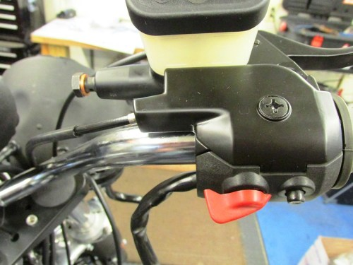 Throttle Cam Cover Captures Throttle Cable And Is Secured By Large Screw