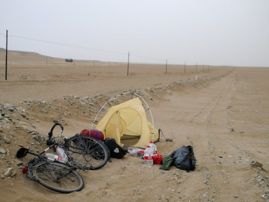 Nightly ritual of: stop; turn 90 degress to the right; walk forward 100 metres; set up inner tent; sleep. This picture was taken in the morning - one day left to get to Hetian.