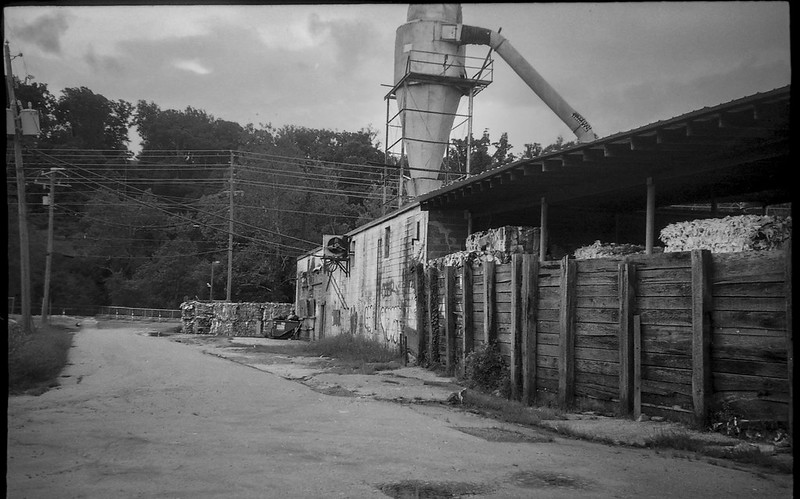 urban decay, architecture, cinderblock and wood, Asheville Waste Paper Company, Asheville, NC, Leica C1, Fomapan 200, Moersch Eco film developer, late August 2020
