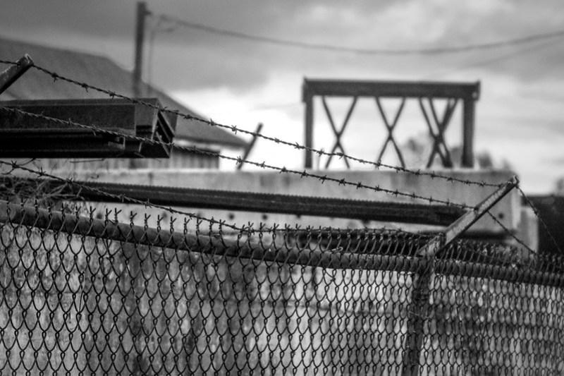 urban landscape, metal fence, barbed wire, architectural forms, dusk, Asheville, NC, Nikon D3300, mamiya sekkor 145mm f-4, 11.8.20