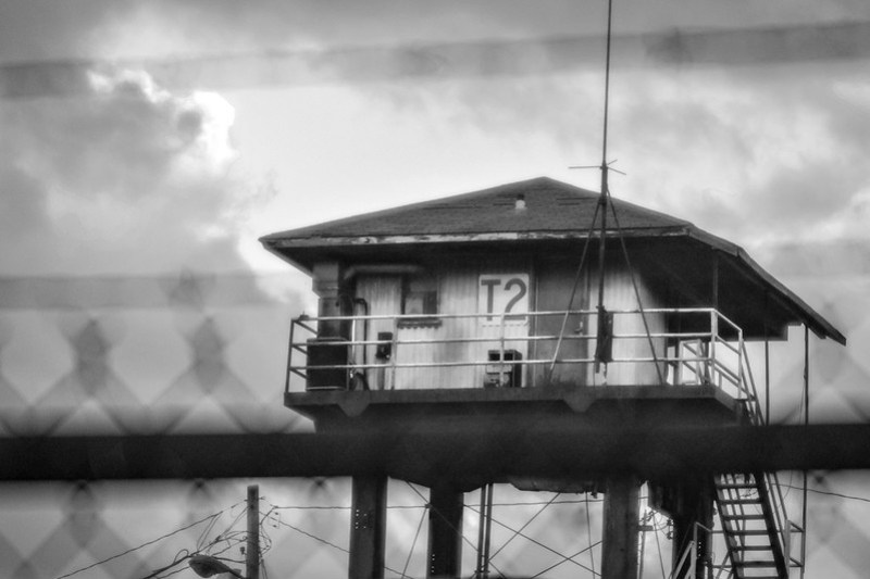 apex, lookout tower, through metal fence and barbed wire, near dusk, Norfolk and Southern Railway, Asheville, NC, Nikon D3300, mamiya sekkor 145mm f-4, 11.8.20