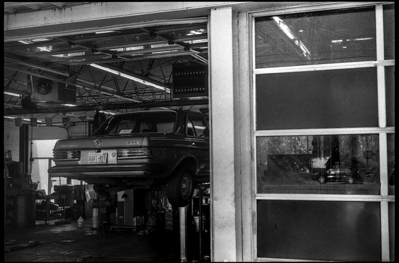 300 turbo diesel, lift, shop door, reflections, Mister Tire, Patton Avenue, Asheville, NC, Minolta XG-M, Super Albinon 28mm f-2.8, Arista.Edu 200, Moersch Eco developer, 11.24.20