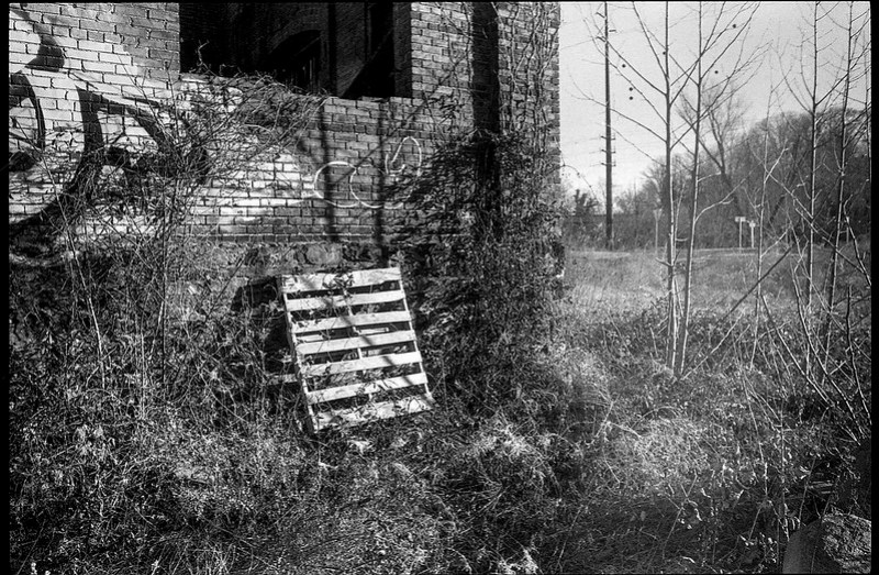 urban decay, architectural facade, abandoned mill, wooden palett, River District, Asheville, NC, Minolta XG-M, Super Albinon 28mm f-2.8, Fomapan 400, HC-110 developer, 1.16.21