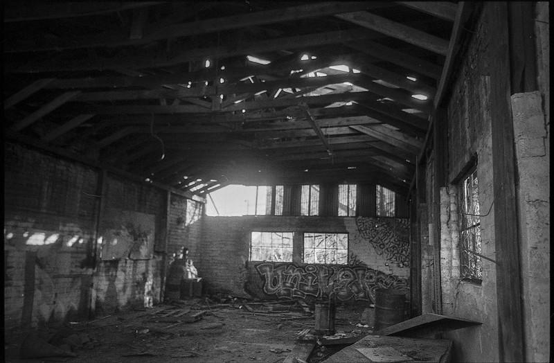 interior, abandoned mill, beautifully lit, urban decay, River District, Asheville, NC, Minolta XG-M, Super Albinon 28mm f-2.8, Fomapan 400, HC-110 developer, 1.16.21