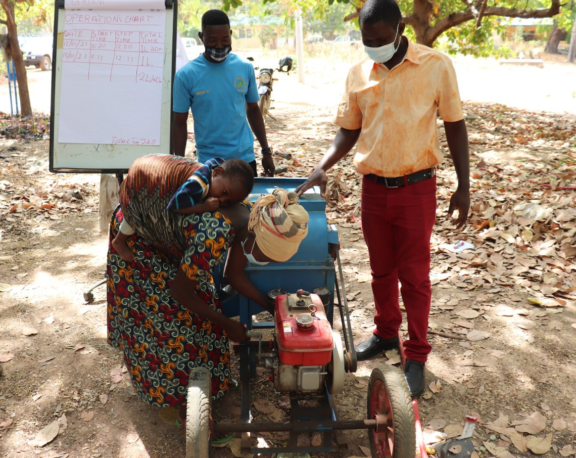 A farmer in Upper West Region, Ghana practices how to start a diesel-powered maize shelling machine. Photo credit: Wilhelmina Ofori Duah/IITA.
