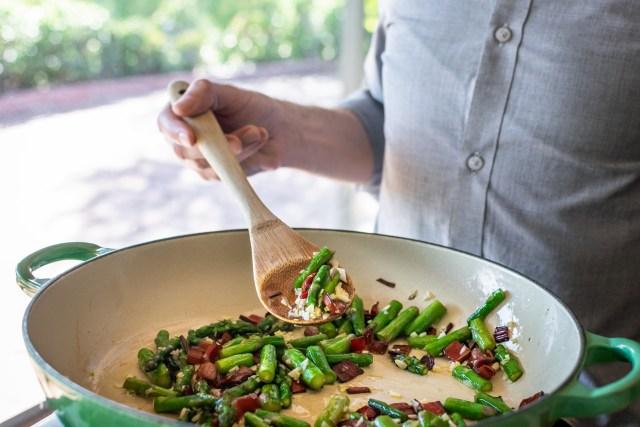 sautéing the asparagus and chard with plenty of garlic