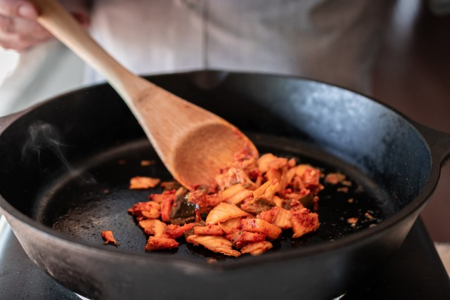 caramelizing the kimchi in butter