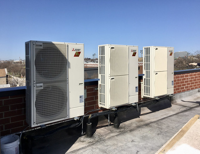 Three outdoor heat pumps on the roof