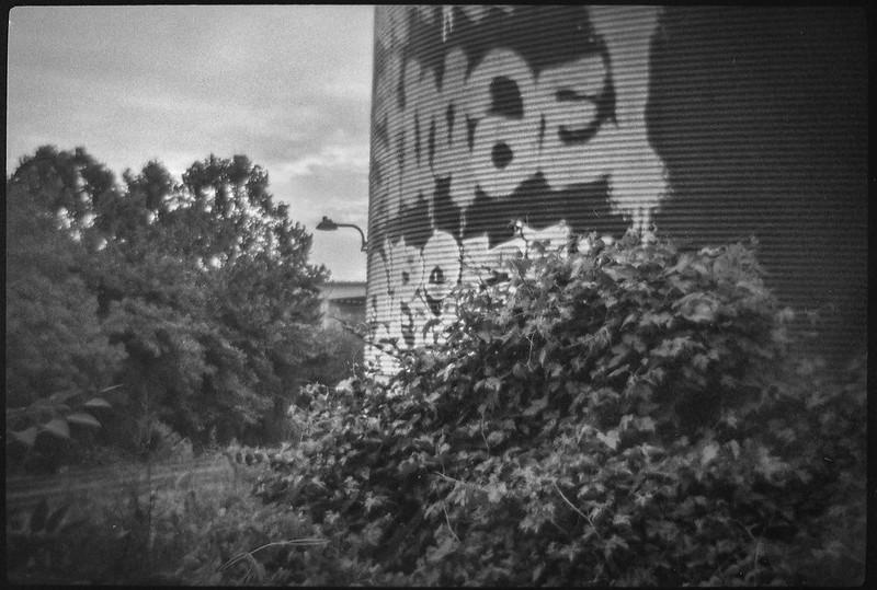 abandoned storage silo (closeup), graffiti, trackside, urban decay, railroad district, Asheville, NC, Bencini Koroll 24S, Fomapan 400, HC-110 developer, 8.30.21
