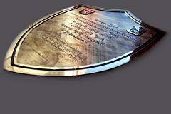 tablica w kształcie tarczy z grubego mosiądzu