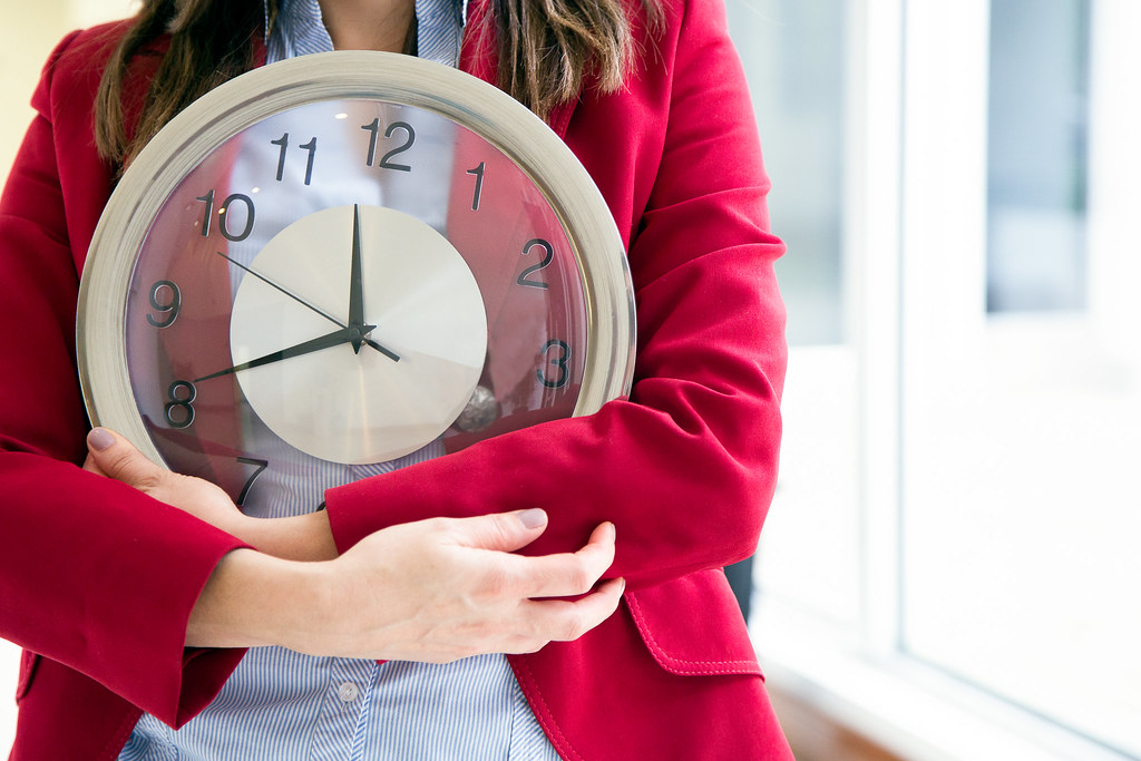 Woman holding clock