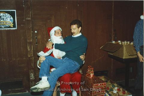 P001.304m.r.t X-mas: man in dark green sweater and white shirt sitting on Santa's lap