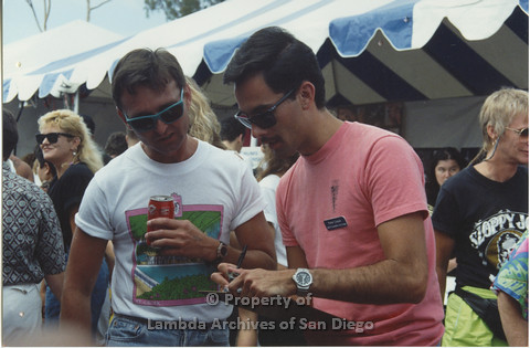 P001.034m.r Pride 1991: 2 men talking (from left to right: uknown, Peter Cooper- AIDS Foundation San Diego)