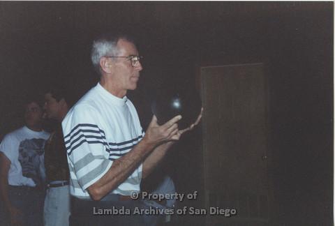 P001.142m.r.t Bowling 1991: Man in stripped shirt holding a bowling ball