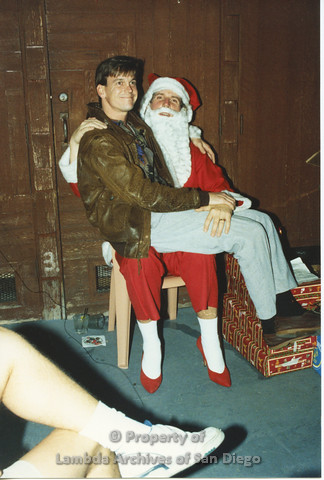 P001.271m.r.t X-mas: man in brown leather jacket sitting on Santa's lap