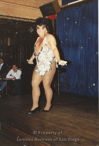 P001.258m.r.t Through The Years Fundraiser: drag queen wearing a floral unitard