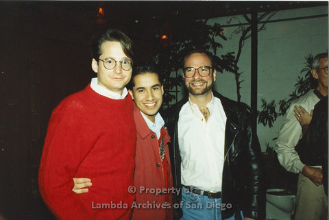 P001.267m.r.t X-mas: 3 men, one wearing a red sweater, one in a leather jacket