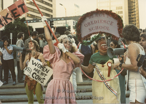 P024.112m.r.t Myth California Protest, San Diego, June 1986: people holding signs
