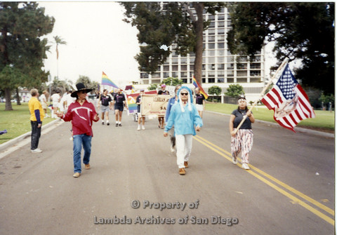 P098.024m.r.t Nations of the 4 Directions marching at San Diego Pride Early 90s at Balboa Park, (L to R) Walter Twofeathers, Jim Abrams, Giselle