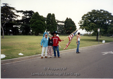 P098.023m.r.t Nations of the 4 Directions marching at San Diego Pride Early 90s at Balboa Park, (L to R) Jim Abrams, Giselle, Walter Twofeathers