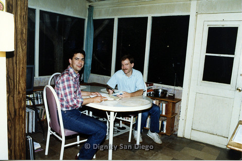 P103.085m.r.t Dignity San Diego: Two men sitting together smiling at camera
