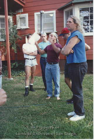 P001.241m.r.t Retreat 1991: group of men outside, one man speaking