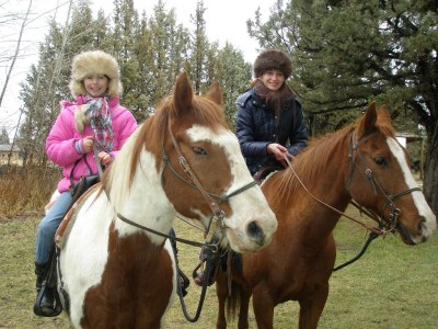 Nina & Monika riding horses.