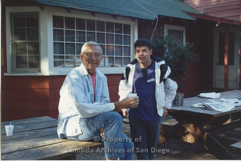 P001.216m.r.t Retreat 1991 : Dr. Bill Crawford and another man outside cabin
