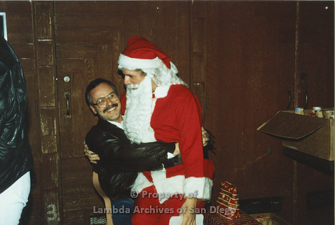 P001.300m.r.t X-mas: Santa sitting on a man's lap wearing a leather jacket
