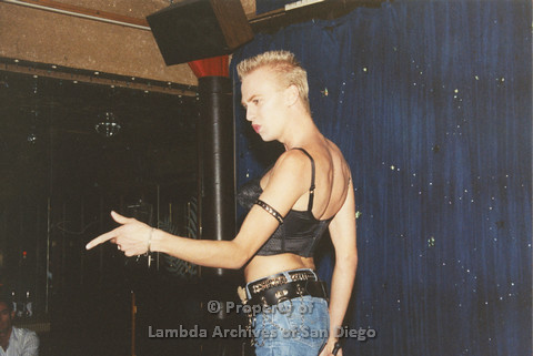P001.256m.r.t Through The Years Fundraiser: drag queen wearing jean shorts and a black top