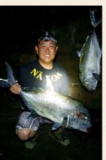 First photo Kavin Akao 30lbs Second photo (this photo) Cory Ito 29lbs Both uluas was our first. Thank you for the tako.