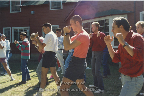 P001.240m.r.t Retreat 1991: men in organized activity outdoors (boxing?)