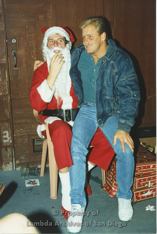 P001.282m.r.t X-mas: man in jean jacket sitting on Santa's lap