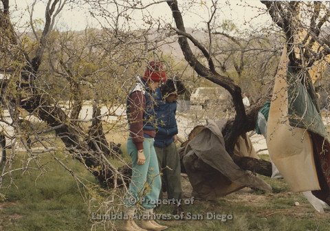 P024.073m.r.t Cathy Moore's 34th Birthday, Halley's Comet Weekend, Anza Borrego Desert 1986: 2 women behind tree branches, both looking down