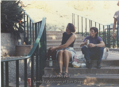 P024.045m.r.t LCCA: Two women eating lunch on stairs outside near West Commons