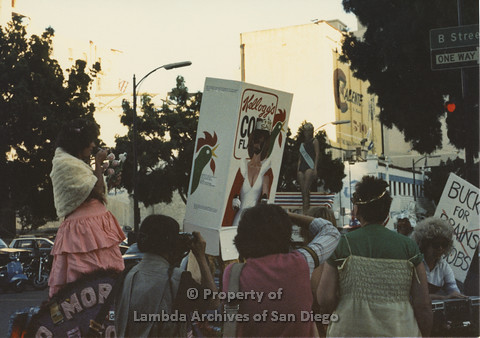 P024.085m.r.t Myth California Protest, San Diego, June 1986: Ann Simonton in Kellogs Corn Flakes Costume standing on a float