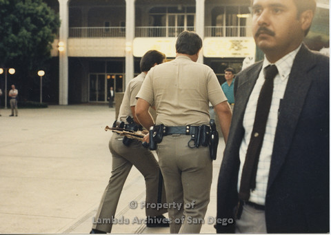 P024.133m.r.t Myth California Protest, San Diego, June 1986: 2 police officers backsides