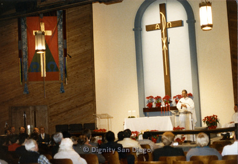 P103.046m.r.t Dignity San Diego: Male church leader on podium, speaking to sitting congregation