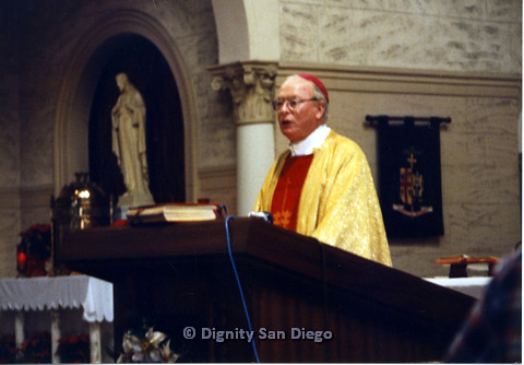 P103.061m.r.t Dignity San Diego: Farther shot of religious leader with red cap and golden robes
