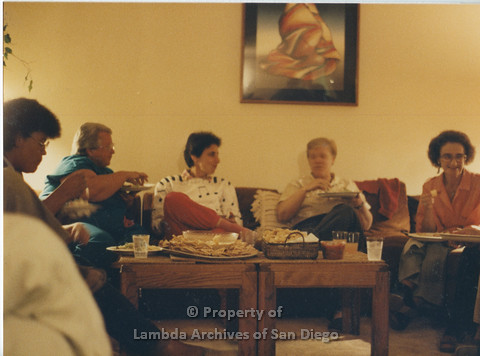 Alix Dobkin Concert, 1985 in the home of Carol Cianfarani: Lesbian Feminists sitting on couch, snacking before the concert. (from left to right: unknown, lla Suzanne (teal blouse) artist, Alix Dobkin - Lesbian Feminist performer, Sally Hopkins - Lesbian