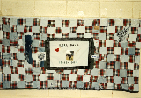 P019.040m.r.t AIDS Quilt at San Diego Golden Hall 1988: Quilt made of plaid checkers dedicated to Ezra Ball