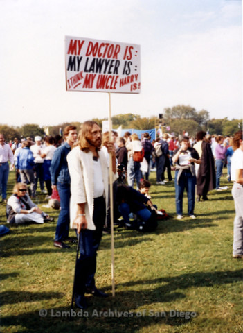 "P019.274m.r.t Second March on Washington 1987: Man with sign that reads: ""MY DOCTOR IS: MY LAWYER IS: I THINK MY UNCLE HARRY IS!"""