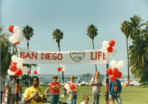 P012.001m.r.t San Diego Walks for Life 1986: Attendees below banner