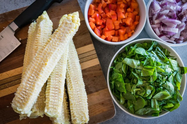 chopped veggies, and naked corn cobs