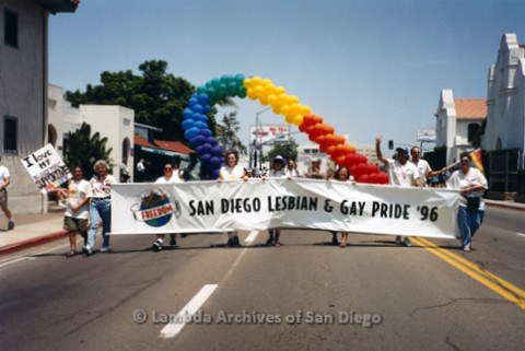"P234.007m.r.t SD Pride Parade 1996: Marchers carrying banner: ""San Diego Lesbian and Gay Pride '96"""